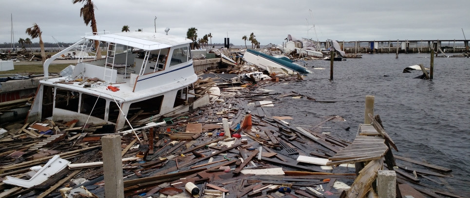 A sunken vessel and floating lumber are a result of Hurricane Michael.