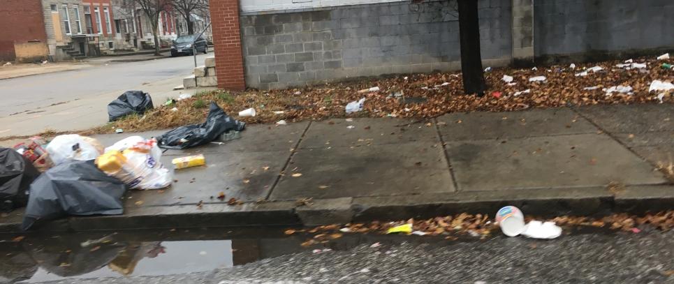 Trash on the sidewalk.