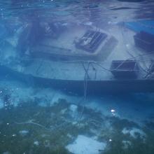 A sunken vessel is viewed underwater and is located in the U.S. Virgin Islands.