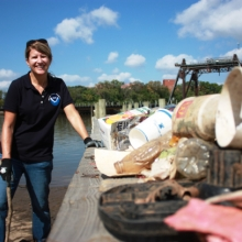 A volunteer stands with some of the haul from the 2015 International Coastal Cleanup.