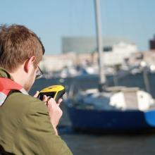 A South Carolina Sea Grant technician takes a GPS point on an ADV.