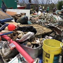 University of the Virgin Islands Master's of Marine and Environmental Science alumna, Kyle Jerris, sorts marine debris at the 2018 Great Mangrove Cleanup on St. Thomas.