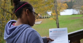 A student looking at her Climate Action Plan at a youth summit.