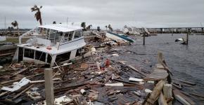 Marine debris piled high along a shore.
