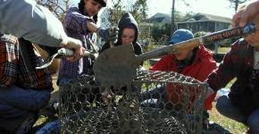 Volunteers re-purposing crab pots.