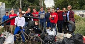 Volunteers posing with trash.