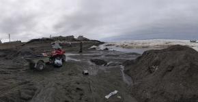 Wildlife staff removing marine debris along the shore of the North Slope Borough of Alaska.