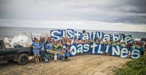 Volunteer clean the beach in Hawaii.