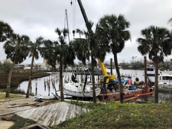 Derelict vessel being removed after Hurricane Michael