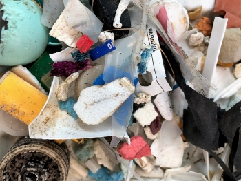 A close up view of microplastics in a pile on a table.