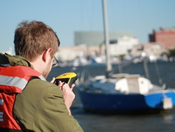 A South Carolina Sea Grant technician takes a GPS point on an ADV.