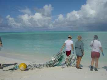 Derelict fishing gear cleanup on a beach in the Northwestern Hawaiian Islands