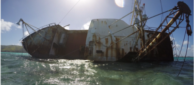 During the Typhoon Soudelor in 2015, the Lady Carolina broke free from its mooring and has since been a fixture in the Saipan Lagoon (Photo: Pacific Coastal Research & Planning).