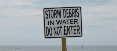 Storm debris beach sign.