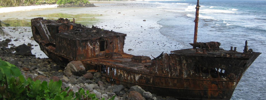 Rusted ship on the beach.