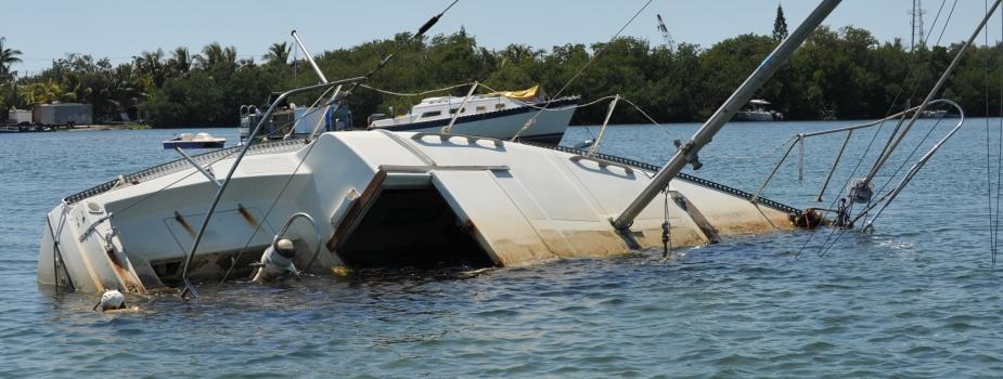 Derelict boat sinking.