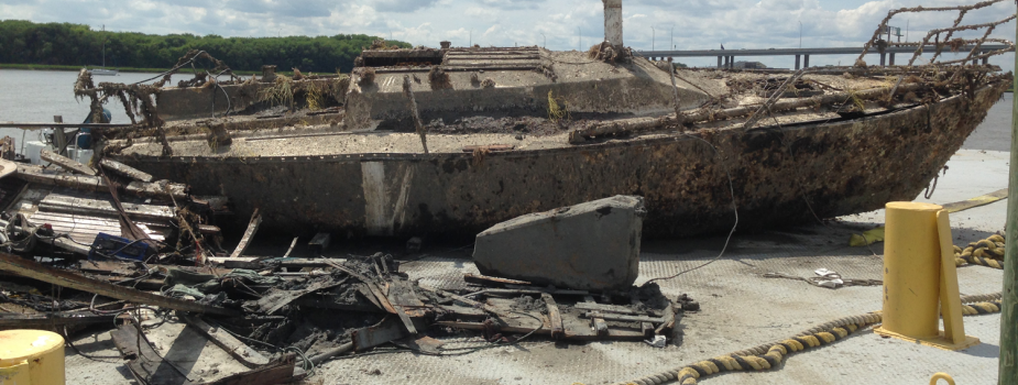 Derelict boat hauled out for disposal.