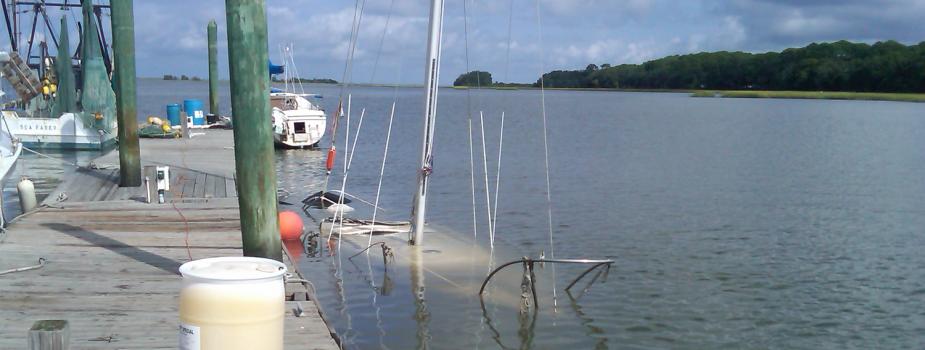 Abandoned sailboat sunk at moorage.