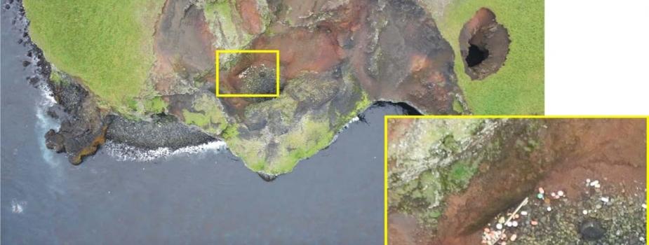 An overhead view of marine debris along a coastline.