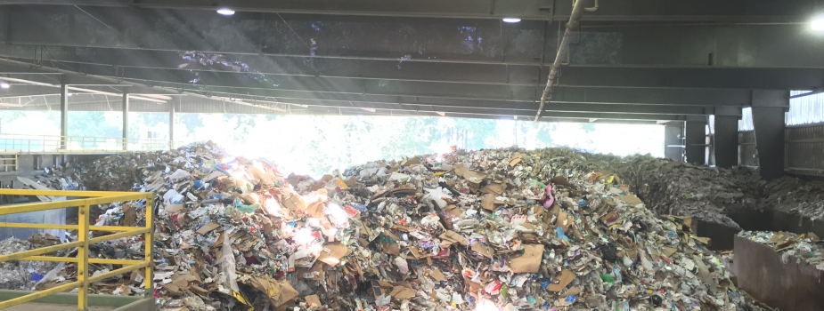A heap of recyclables at a recycling center.