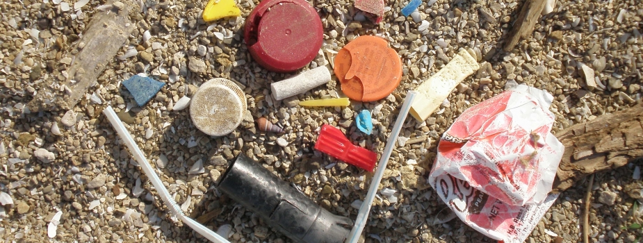 Various marine debris items on a beach.