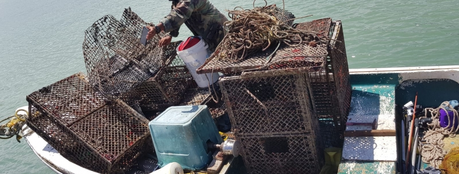 A fishing vessel loaded with derelict fishing gear.