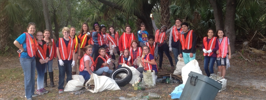 A group of students with trash they collected.