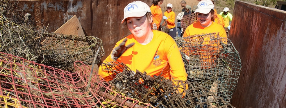 "Volunteers fill a container with derelict crab traps collected during a ""Derelict Crab Trap Rodeo"" in 2014. (Photo Credit: Louisiana Sea Grant)"