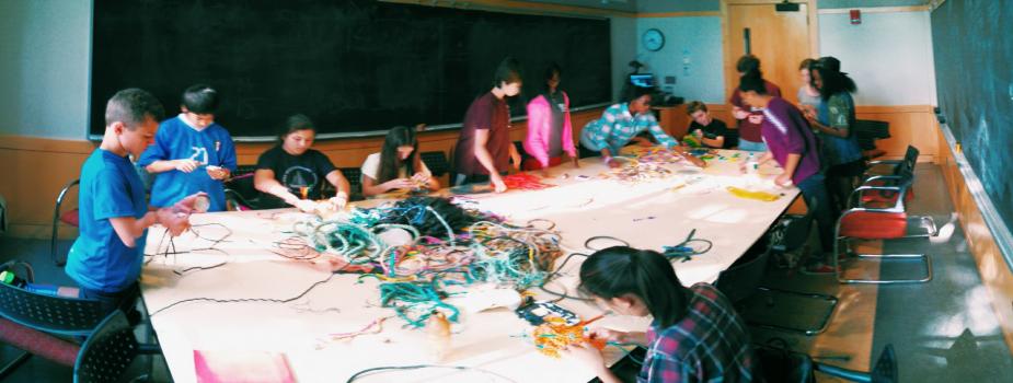 Kids working on marine debris art around a table.