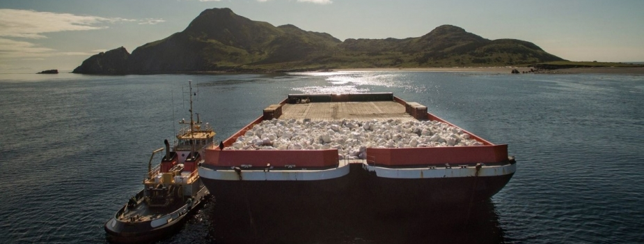 A barge carrying bags of marine debris.