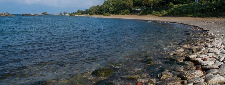 A rocky lake shoreline.