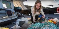 Woman sorts through marine debris.